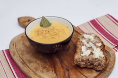 A bowl of butternut squash soup. With bread and gorgonzola cheese Stock Images