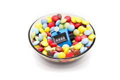 Bowl of candies with Hand tally - concept of excess sugar Royalty Free Stock Image