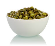 Bowl with capers isolated Stock Photos