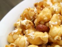 Bowl of caramel popcorn Stock Images