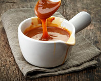 Bowl of caramel sauce Royalty Free Stock Photos