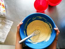 Bowl carrying by two hands with dough inside royalty free stock photography