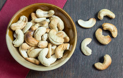 Bowl of cashew nuts from above. On wood background. Stock Image