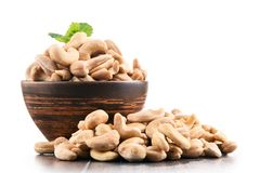 Bowl with cashew nuts  on white Royalty Free Stock Photography
