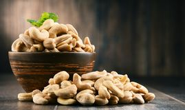 Bowl with cashew nuts on wooden table. Delicacies royalty free stock photo