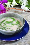Bowl of Cendol Traditional Sweet. Close up bowl of Cendol traditional sweet with orchid on background stock images