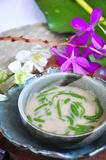 Bowl of Cendol Traditional Dessert with Orchid on Background. Bowl of Cendol traditonal dessert with orchid decorated on background stock images