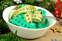 Bowl with centimeter and christmas decoration Stock Photos