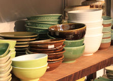 Bowl ceramic pottery stacked in store shelf hand made craft Stock Photo