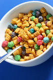 Bowl of cereal. In white bowl on blue background Royalty Free Stock Photography