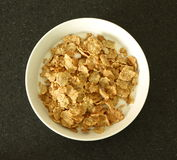 Bowl of Cereal. A bowl of cereal on a table stock photography