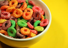 Bowl of cereal. Bowl of colorful cereal on yellow background Stock Photos