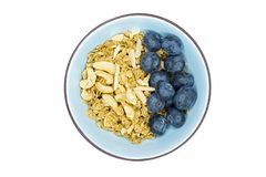 a bowl of cereal with blueberries royalty free stock photo