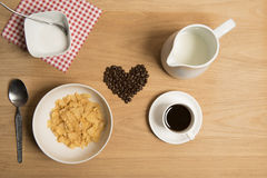 Bowl of cereal with coffee, coffee beans, milk and sugar. Stock Photography