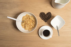 Bowl of cereal with coffee, coffee beans, milk and sugar. Stock Image