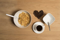 Bowl of cereal with a cup of coffee and sugar Royalty Free Stock Photo