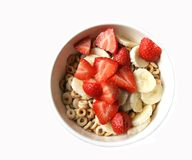 Bowl of cereal with fruit Stock Images
