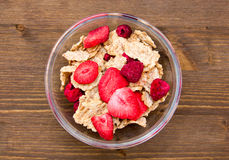 Bowl with cereal and fruit on wood from above Royalty Free Stock Images