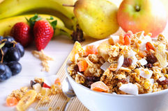 Bowl of cereal and fruits closeup Stock Image