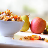 Bowl of cereal and fruits with diagonal composition in kitchen Royalty Free Stock Photography