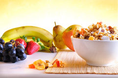 Bowl of cereal and fruits overview Royalty Free Stock Images