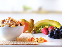 Bowl of cereal and fruits overview in the kitchen Stock Images