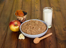 Bowl  cereal,  glass  milk, dry fruits, nuts  on  dark wood. Stock Images