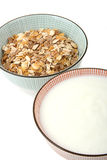 Bowl of cereal and milk. Breakfast, two bowls once of cereal and once of milk royalty free stock image