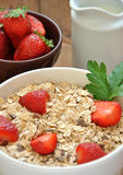 Bowl of cereal with milk and strawberries Royalty Free Stock Images