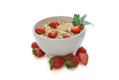 Bowl of cereal with milk and strawberries Stock Images