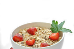 Bowl of cereal with milk and strawberries Royalty Free Stock Photos