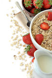 Bowl of cereal with milk and strawberries Royalty Free Stock Photo