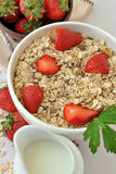Bowl of cereal with milk and strawberries Stock Photography
