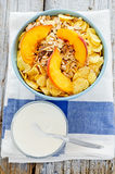 Bowl of cereal with muesli and fresh peach Stock Images