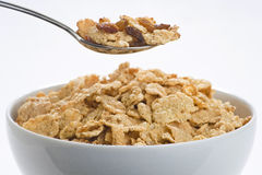 Bowl of cereal with raisins and milk Royalty Free Stock Photo