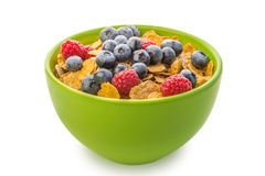 A bowl of cereal with raspberries and blueberries Royalty Free Stock Images
