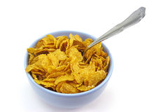 Bowl of cereal with spoon (clipping path included). Cereal flakes in a blue bowl on white background with clipping path included Stock Photography