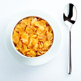 Bowl of cereal and spoon set for breakfast Stock Images