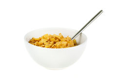Bowl of cereal with spoon on white. Bowl of cereal with spoon on a white background Stock Photo