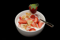 Bowl of cereal with strawberries. And spoon Stock Photos