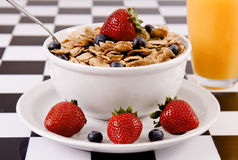 Bowl of cereal with strawberries and blueberries Stock Photo