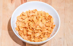 Bowl of cereal on a wooden table background Royalty Free Stock Photo