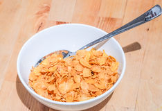 Bowl of cereal on a wooden table background Royalty Free Stock Images