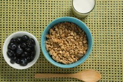 Bowl of cereals and blueberries with glass of yogurt for breakfast Stock Photography