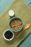 Bowl of cereals and blueberries with glass of yogurt for breakfast Stock Image