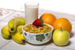 Bowl of cereals with fruit and milk Stock Photos