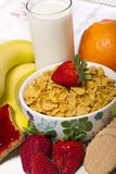 Bowl of cereals with fruit and milk Stock Photo