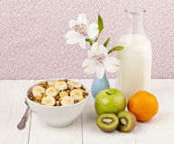 Bowl of cereals with fruits and milk Stock Photos
