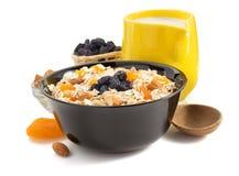 Bowl of cereals muesli on white Royalty Free Stock Image