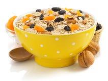 Bowl of cereals muesli on white Stock Photos